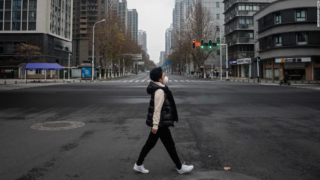 WUHAN, CHINA - JANUARY 27: (CHINA-OUT) A woman walks on an empty road on January 27, 2020 in Wuhan, China. As the death toll from the coronavirus reaches 80 in China with over 2700 confirmed cases, the city remains on lockdown for a fourth day. (Photo by Getty Images)